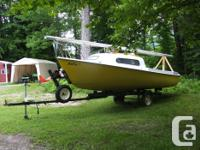 17 foot siren sailboat in good condition. Includes main