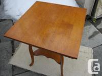 THIS UNIQUE TABLE IS PART 1/4 CUT OAK. THE TOP IS 24