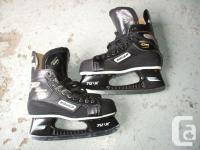 Available; Bauer Supreme 1000 hockey skates. Rigid boot