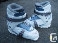 Five pairs of youth-size alpine ski boots for sale. All