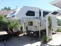 Spacious living with slide out. Generator, full bath,
