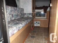 slide in truck camper with large bed and bathroom. Has