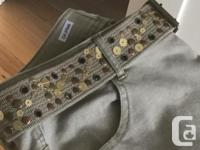 Khaki denims with sequin trim on belt and pockets. Slim