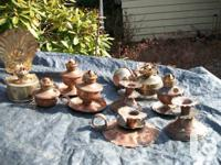 copper and brass   oil lamps and a few copper candle