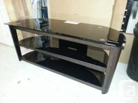 This 3 shelf smoked glass TV stand is in perfect