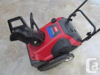 Toro 2 stage snow blower. 5 hp engine. 20 inches wide.