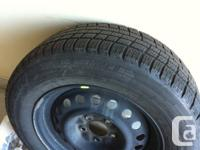 Michelin snow tires with rims  215/65r/16  used only