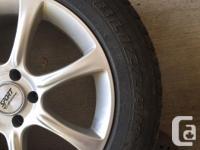 4-Bridgestone Blizzak winter tires mounted on rims