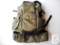 This is a Snugli infant baby carrier. It is an olive
