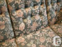 Three seat upholstered sofa and arm chair. Cushions are