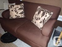 2 yr old brown material sofa and love seat available