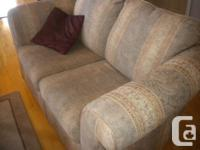 Sofa and love seat for sale. Light green/gold pattern.