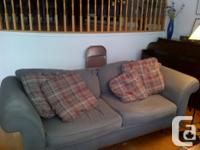Grey matching couches. Good shape. Material is a kind