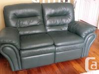 Green, genuine all leather sofa and matching motion
