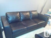 Leather-made Sofa. a black natural leather 2 seater