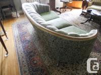 Antique style three seater couch in good condition.