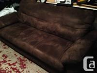 Sofa - dark brown. One year old.  In very good
