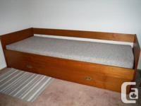Single dimension day bed or sofa. Solid wood with
