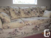 3 seat sofa in fair condition, light beige with floral