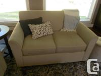 Oatmeal colored fabric sofa and loveseat In excellent