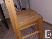 Solid wood. Has a few dings since it's soft wood but