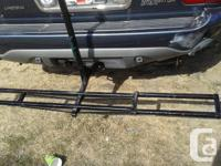 THIS BLACK CAST IRON DIRT BIKE HOLDER,IS SOLD ,AND MADE