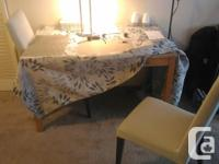 For sale a Solid - Dining Table and Two Chairs, made of