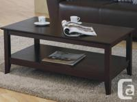 Compact solid hardwood coffee table with lower shelf.