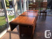 Solid hardwood dining table with 4 matching chairs.