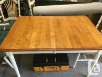 This is a solid maple set. Included are a table with