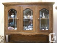 Attractive buffet and hutch; made of solid oak;