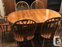 This is a dining room table and chair set made of solid for sale  British Columbia