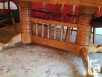 """Solid Oak 60: table with 2 - 18"""" leaf inserts, which"""