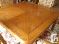 Table size is 42 x 42 and expands with two leaves to