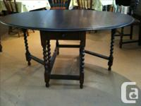 Jacobean style oval drop leaf table with barley twist