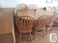 """Classic oak dining room set for sale. Table is 44"""""""