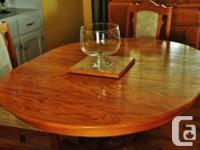 Beautiful solid honey oak single pedestal table and 4