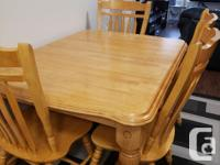 Huge dining table with leaf and six chairs, this table