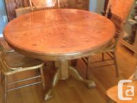 "Very solid set table goes from 46"" round to 70"" oval,"
