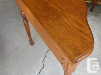 THIS HALF MOON END TABLE IS 27 INCHES LONG, 11 INCHES