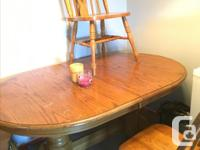 Solid oak table, comes with 4 chairs and leaf. Some