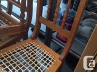 """Solid African Oak table and 8 chairs measuring 62"""" x"""