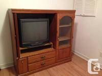 Beautiful Solid Oak TV and home theatre wall unit. Fold