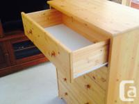 Wood finished, pine, 5-drawer dresser. 16in deep x
