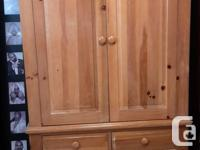 This 2 piece solid pine armoire is in excellent