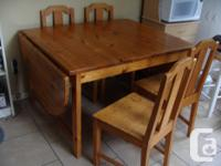For sale, solid pine table with four chairs, one needs