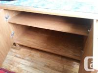 "This solid teak unit measures 66"" long, 21 and 1/2"""