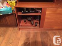 Large solid teak wallunit purchased in 1980's with fold