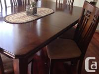 Solid wood 6 feet long dining table, 2 years old with 6