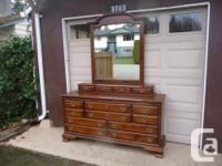 solid wood 8 drawer triple dresser, top six drawers are